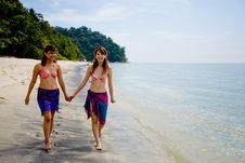 Girlfriends Strolling By The Beach Royalty Free Stock Photography