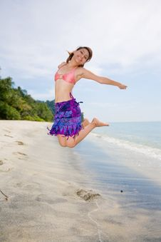 Free Jumping Freely At The Beach Stock Images - 4413414