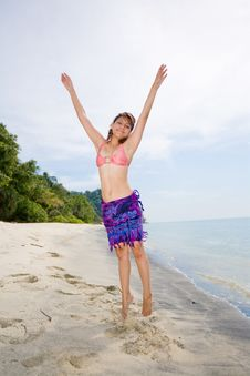 Free Jumping Freely At The Beach Royalty Free Stock Photography - 4413567
