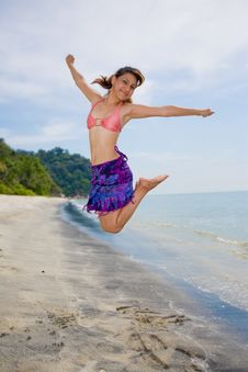 Jumping Freely At The Beach Stock Photo