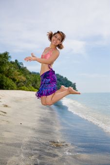 Jumping Freely At The Beach Royalty Free Stock Photography
