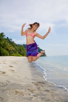 Jumping Freely At The Beach Royalty Free Stock Images
