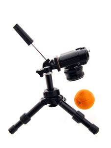 Free Photographing Of Orange. Black Tripod And Camera Royalty Free Stock Photo - 4414305