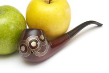 Long Ornamented North-caucasian Pipe With Apples Royalty Free Stock Photos