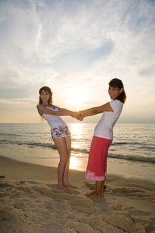 Free Two Girls Having Fun At The Beach Royalty Free Stock Photography - 4414917
