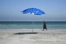 Free Women And Beach Umbrella Stock Photo - 4416800