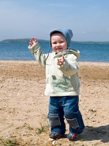 Free Happy Boy Walking On The Seaside Royalty Free Stock Photography - 4418487