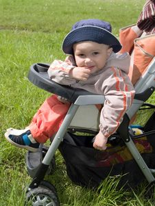 Boy In The Stroller Royalty Free Stock Images