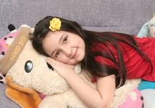 The Nice Girl Lays On The Big Soft Toy Stock Photos