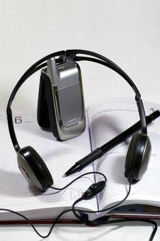 Earphones And Mobile Telephone Stock Photo