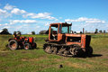 Free Old Tractors On The Field Royalty Free Stock Images - 4424359