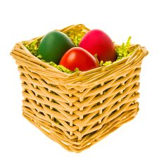 Multi-coloured Eggs In A Basket Royalty Free Stock Images