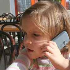Free Kid Having A Telephone Call Stock Photography - 4422472