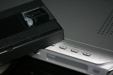 VHS On A Silver DVD Player Royalty Free Stock Photography