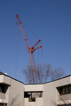 Free Red Crane Over Building Stock Image - 4425251