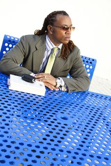 Free Man Sitting At A Table Stock Photography - 4427202