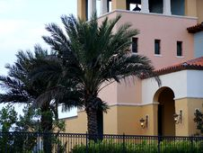 Free Palm Trees By Spanish Style Building Stock Image - 4427291