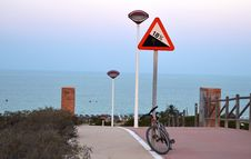 Bike Parked Above A Calm Sea Royalty Free Stock Image