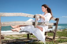 Free Woman Relaxing On The Bench Stock Images - 4432544