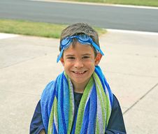 Boy With Beach Towel Stock Photo