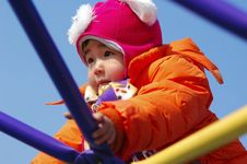 Free Girl Playing On Climbing Frame Royalty Free Stock Image - 4433586