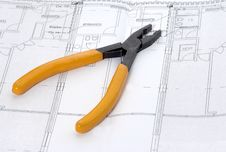 Free Pliers And House Plan Stock Photography - 4435812