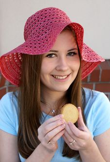 Free Pretty Girl Wearing Red Hat Holding Cookie Royalty Free Stock Image - 4436506