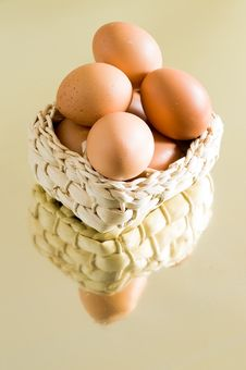 Farm-fresh Eggs In A Basket Stock Photo