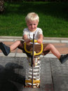 Free Young Boy Swinging At Playground Stock Photos - 4443253