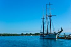 Free A Sailing Ship Anchored To The Shore Stock Images - 4444964