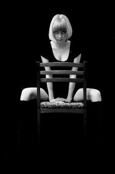 Free Blonde With A Passionate Sight Sits On A Chair Stock Photo - 4447930