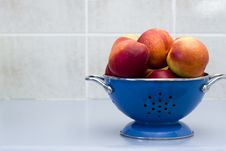 Free Bowl Of Nectarines In A Blue Colander Stock Photography - 4449102
