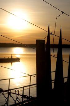 Free Sunrise Behind Fence Royalty Free Stock Images - 4449919