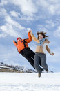 Free Couple Of Teens Jumping Royalty Free Stock Photography - 4455107