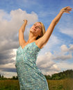 Free Woman Over Blue Cloudy Sky Stock Photo - 4457480