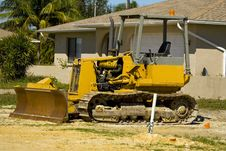 Free A Small Bulldozer At A Job Site Stock Images - 4451094