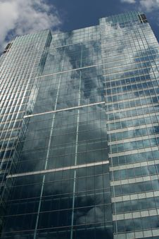 Free Clouds Reflecting On Side Of Glass Building Royalty Free Stock Photography - 4460057