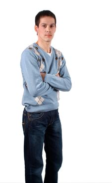 Young Man Stands Cross Hands Royalty Free Stock Photography