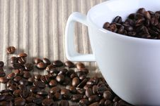 Coffee Cup Full Of Coffee Beans Stock Image