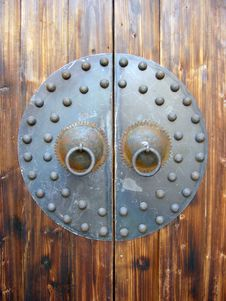 Free Chines Ancient Iron Decoration On Wooden Door Stock Image - 4466021