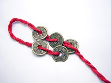 Free Five Chinese Ancient Coins Chained With Red Cord Stock Photography - 4466192