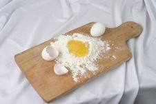 Free Eggs And A Flour On A Board Stock Image - 4466451