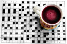 Cup With Crossword Stock Images