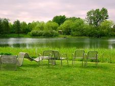 Chairs In Park Overlooking The Lake Royalty Free Stock Photos