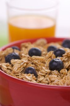 Bowl Of Granola And Blueberries And Juice Stock Photo