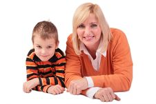 Middleaged Woman With Boy Lying Stock Images
