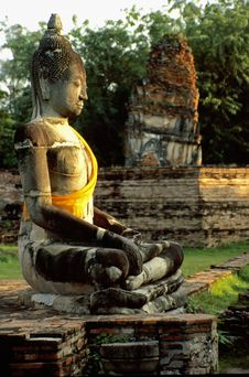 Buddha Statue With Yellow And Orange Cape Royalty Free Stock Image