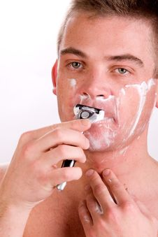 Shaving His Face Royalty Free Stock Image