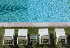 Lounge Chairs By Resort Pool Royalty Free Stock Images