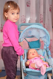 Free Small Girl With Doll In Carriage 2 Stock Image - 4485081